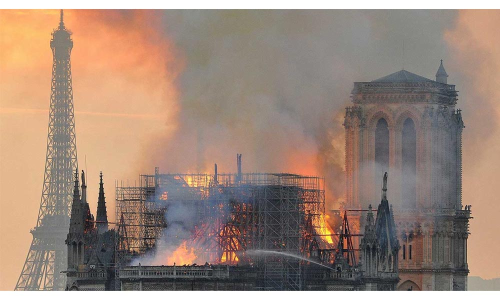 Thick smoke and flames were leaping off Notre-Dame cathedral into the Paris sky